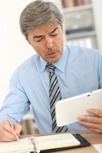 A business owner reviewing his business externally and internally